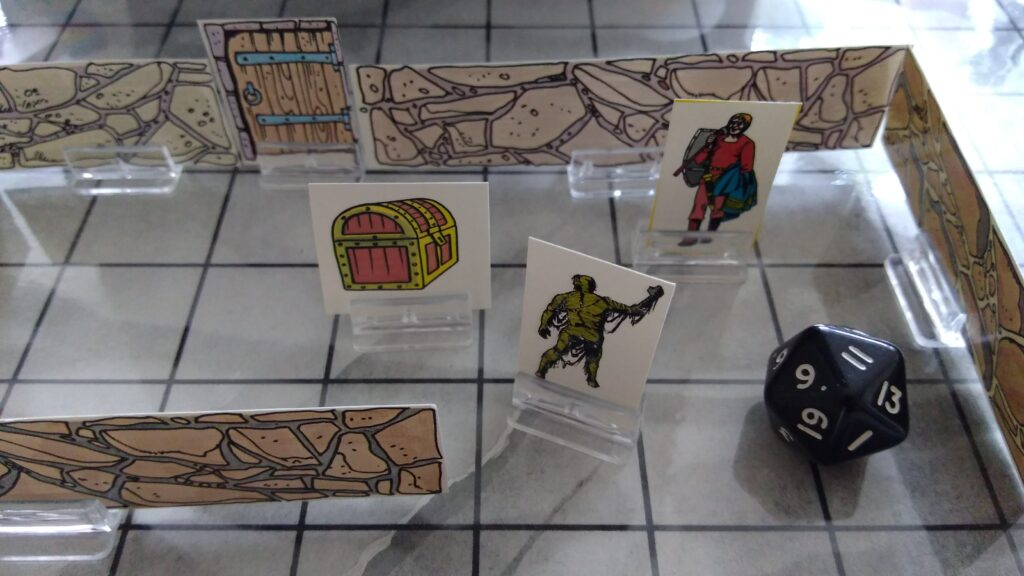 De oude kartonnen figuurtjes uit de instrumenten van de Meester.